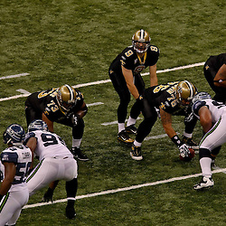 November 21, 2010; New Orleans, LA, USA;  New Orleans Saints quarterback Drew Brees (9) under center during the first quarter against the Seattle Seahawks at the Louisiana Superdome. The Saints defeated the Seahawks 34-19. Mandatory Credit: Derick E. Hingle