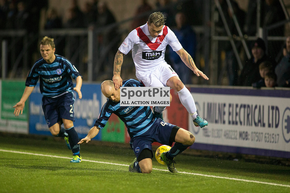 Kevin Nicoll (Forfar 4) and David Cox (Airdrie 10) in the Forfar Athletic v Airdrie Station Park, Forfar, 07 November 2015<br />