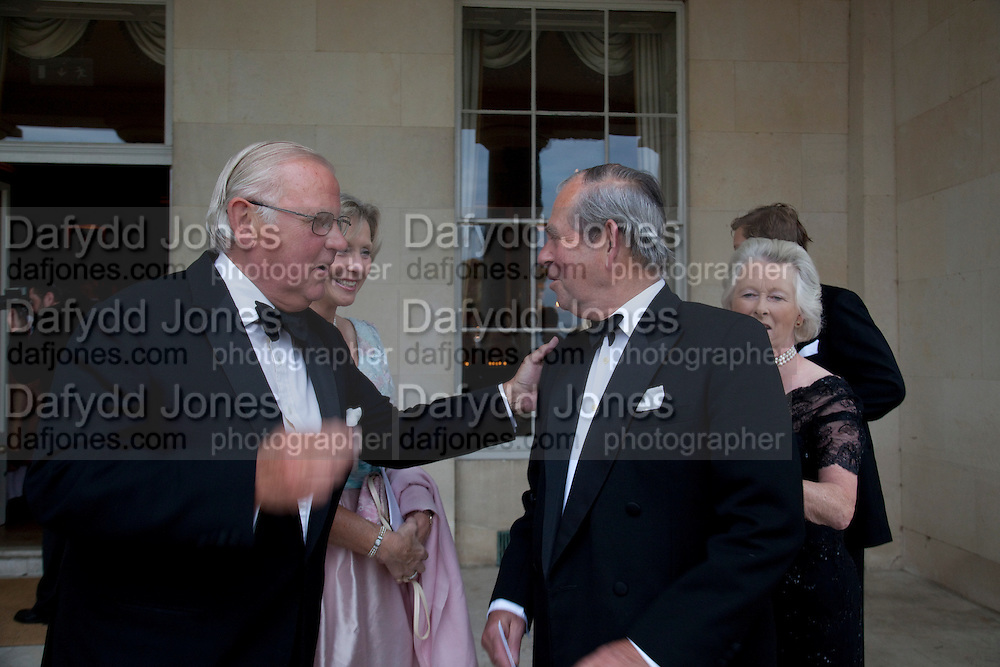 SIR CHARLES LOWTHER; LADY LOWTHER; SIR BRIAN BARTLETT, , The Goodwood Ball. In aid of Gt. Ormond St. hospital. Goodwood House. 27 July 2011. <br /> <br />  , -DO NOT ARCHIVE-© Copyright Photograph by Dafydd Jones. 248 Clapham Rd. London SW9 0PZ. Tel 0207 820 0771. www.dafjones.com.