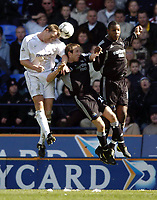 Photo. Jed Wee.<br /> Bolton Wanderers v Newcastle United, FA Barclaycard Premiership, Reebok Stadium, Bolton. 28/03/2004.<br /> Bolton's Kevin Davies (L) wins the ball against Newcastle's Lee Bowyer (C) and Titus Bramble.