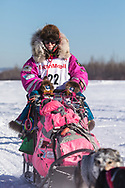 Musher DeeDee Jonrowe competing in the 45rd Iditarod Trail Sled Dog Race on the Chena River after leaving the restart in Fairbanks in Interior Alaska.  Afternoon. Winter.