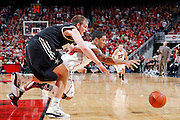 LOUISVILLE, KY - DECEMBER 2: Peyton Siva #3 of the Louisville Cardinals dives for a loose ball against Brad Tinsley #1 of the Vanderbilt Commodores at KFC Yum! Center on December 2, 2011 in Louisville, Kentucky. Louisville defeated Vanderbilt 62-60 in overtime. (Photo by Joe Robbins) *** Local Caption *** Peyton Siva;Brad Tinsley