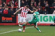 Sean Long and George Cooper  during the EFL Sky Bet League 2 match between Cheltenham Town and Plymouth Argyle at Jonny Rocks Stadium, Cheltenham, England on 26 December 2019.