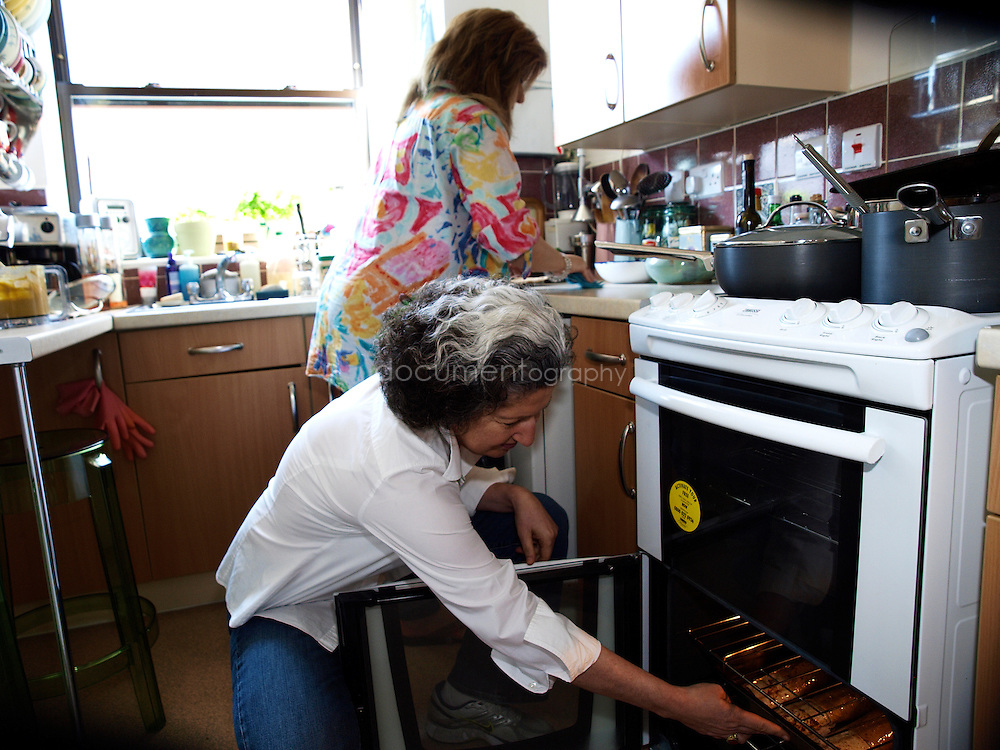 Lebanese Chef Anissa Helou (front) and Palestinian singer Reem Kelani preparing a Palestinian meal in Reem's house in London.