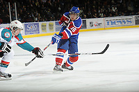 KELOWNA, CANADA, FEBRUARY 15: TJ Foster #16 of the Edmonton Oil Kings takes a shot on net at the Kelowna Rockets on February 15, 2012 at Prospera Place in Kelowna, British Columbia, Canada (Photo by Marissa Baecker/Shoot the Breeze) *** Local Caption ***