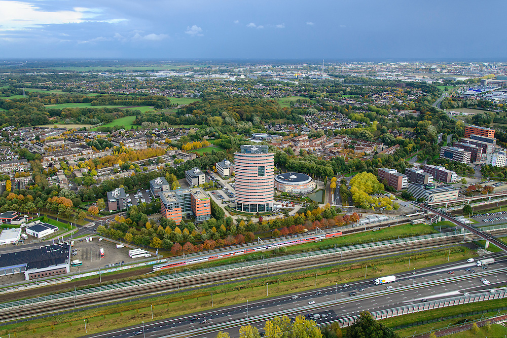 Nederland, Noord-Brabant, Gemeente Breda, 23-10-2013; Breda-Prinsenbeek, infrastructuur-bundel bestaande uit Rijksweg A16, HSL en regulier spoorlijn. Intercity Direct (voorheen Fyra) buig af richting Breda.<br /> Infrastructure bundle consisting of A16, HST and regular rail (Breda, southern Netherlands)<br /> luchtfoto (toeslag op standard tarieven);<br /> aerial photo (additional fee required);<br /> copyright foto/photo Siebe Swart