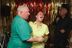 Man with disability with carer enjoy dancing on holiday in Blackpool.