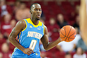 FAYETTEVILLE, AR - NOVEMBER 13:  Christopher Hyder #0 of the Southern University Jaguars dribbles the ball down the court during a game against the Arkansas Razorbacks at Bud Walton Arena on November 13, 2015 in Fayetteville, Arkansas.  (Photo by Wesley Hitt/Getty Images) *** Local Caption *** Christopher Hyder