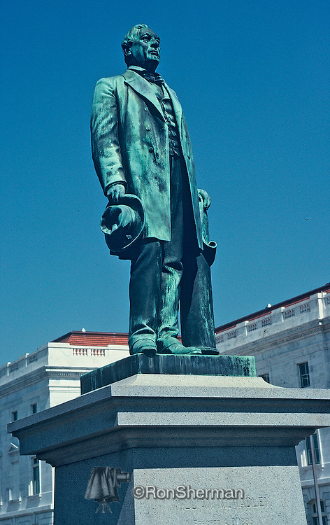 The statue of William Morrill Wadley, president of the Central of Georgia Railroad from January 1866 to August 1882  stands at the intersection of Third and Mulberry Streets in downtown Macon . Wadley took a railroad that had seen 170 miles of track destroyed by war and returned it to prosperity. Though his achievement was not without its shortcomings, he succeeded in making the Central the most powerful corporation in Georgia and one of the finest railroad properties in the South..Macon is a city located in central Georgia, US. Founded at the fall line of the Ocmulgee River, it is part of the Macon metropolitan area, and is the county seat of Bibb County. It lies near the geographic center of Georgia, approximately 85 miles south of Atlanta, hence the city's nickname as the Heart of Georgia. After voters approved the consolidation of Macon and Bibb County in 2012, Macon became Georgia's fourth-largest city, with a population of 155,547 based on 2010 Census figures for Bibb County.