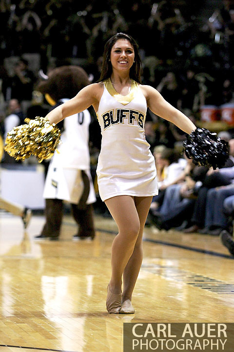January 27th, 2013 Boulder, CO - A Colorado cheerleader dances on the court during a time out in the action of the NCAA basketball game between the California Golden Bears and the University of Colorado Buffaloes at the Coors Events Center in Boulder CO