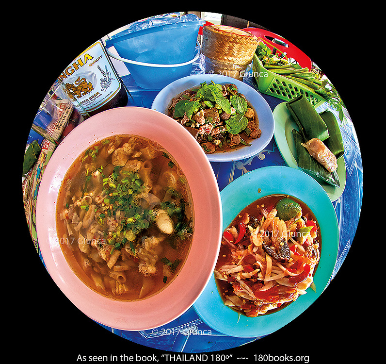 Clockwise from Left: Spicy Beef Organ Soup (Tom Saap), Spicy Sliced Pork with Mint Leaves (Moo Nam Tok), and Fresh Isaan Sausage Wrapped in Banana Leaves, Shredded Papaya Salad with Fresh Chillies, Fermented Fish Paste, and Land Crab (Som Tom Boo Pla-Ra).