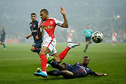 Monaco's French forward Kylian Mbappe Lottin is tackled by Paris Saint-Germain's Ivorian defender Serge Aurier during the French League Cup, Final football match between AS Monaco and Paris Saint-Germain FC on April 1, 2017 at the Parc Olympique Lyonnais stadium in Decines-Charpieu near Lyon, France - Photo Benjamin Cremel / ProSportsImages / DPPI