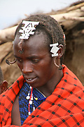 Portrait of a young Maasai tribesman. Maasai is an ethnic group of semi-nomadic people. Photographed in Tanzania