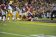 Ole Miss' defensive lineman Bryon Bennett (95) and Ole Miss' defensive back Senquez Golson (21) celebrate as Ole Miss' defensive back Cody Prewitt (25) recovers an LSU fumble in the end zone at Tiger Stadium in Baton Rouge, La. on Saturday, October 25, 2014.