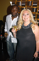 VANESSA FELTZ and DENNIS DUHANE at the launch party for the 'Second Floor at Kettner' 29 Romilly Street, London W1 on 4th May 2006.<br />