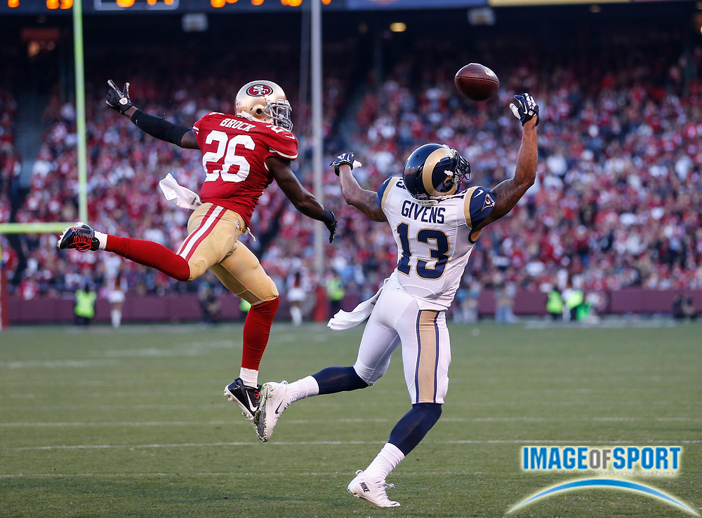 Dec 1, 2013; San Francisco, CA, USA; A pass is incomplete to St. Louis Rams wide receiver Chris Givens (13) who is defended by San Francisco 49ers cornerback Tramaine Brock (26) at Candlestick Park. The 49ers defeated the Rams 23-13.