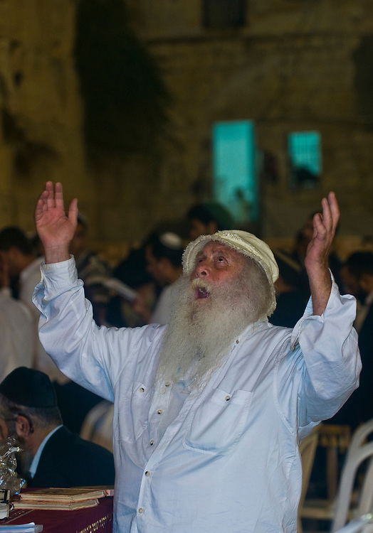 "JERUSALEM - SEP 26 : Jewish old man prays during the penitential prayers the ""Selichot"" , held on September 26 2011 in the ""Wailing wall""  in  Jerusalem , Israel"