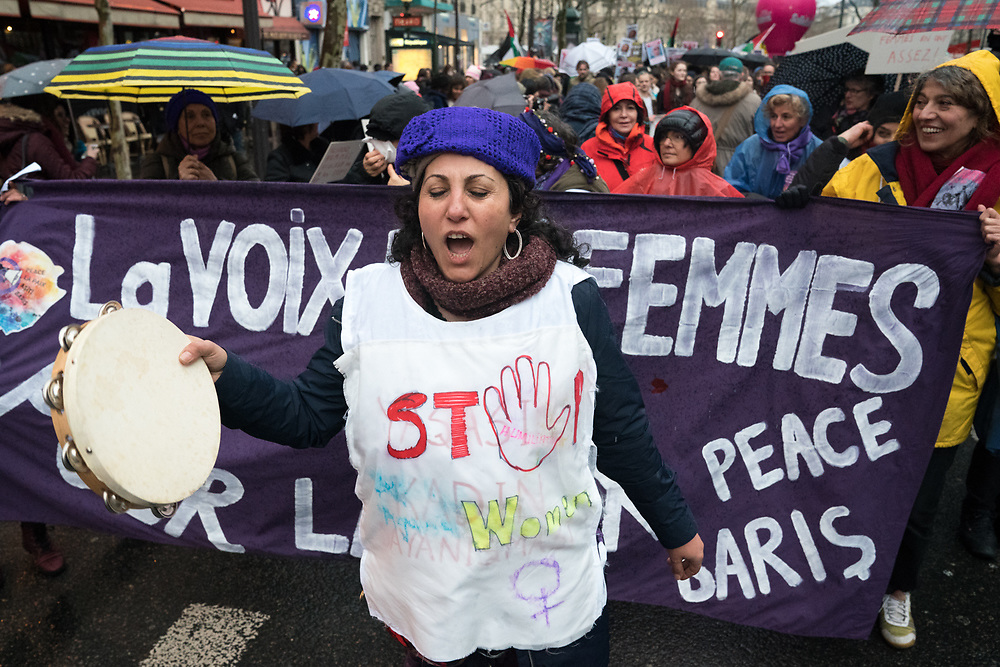 France, Paris, 8 March 2018. International Women's Day.  Despite the rain, hundreds of women gather and march to claim equality between women and men.