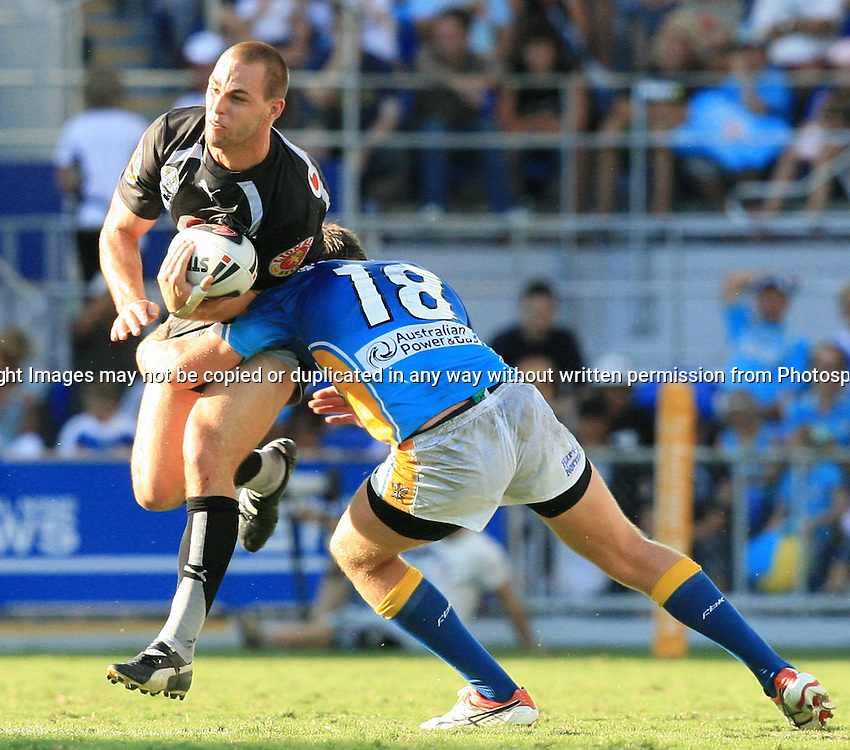 Simon Mannering met with a strong tackle from Gavin Cooper during round 7 of the NRL - Gold Coast Titans v New Zealand Warriors. Played at Skilled Stadium, Robina QLD. Titans (36) defeated the Warriors (24).  Photo: Warren Keir (Photosport NZ).<br /> <br /> Use information: This image is intended for Editorial use only (e.g. news or commentary, print or electronic). Any commercial or promotional use requires additional clearance.