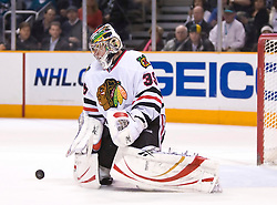 January 28, 2010; San Jose, CA, USA; Chicago Blackhawks goalie Cristobal Huet (39) makes a save against the San Jose Sharks during the third period at HP Pavilion. Chicago defeated San Jose 4-3 in overtime. Mandatory Credit: Jason O. Watson / US PRESSWIRE