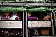 Aung Mingalar district , the center of Sittwe . The Muslim population , to move has to be recorded , counted and loaded on a truck by police with the assistance of a local collaborator.<br />Sittwe, Myanmar July 2016 @Giulio Di Sturco