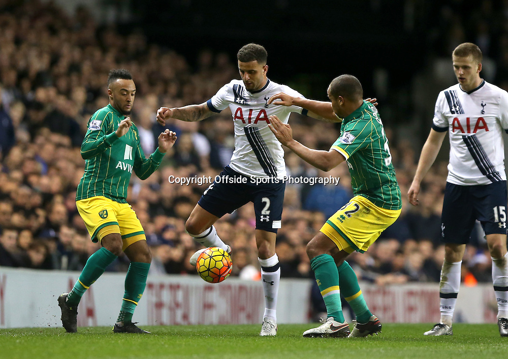 26 December 2015 - Premier League - Tottenham Hotspur v Norwich City<br /> Kyle Walker of Spurs tries to keep the ball from Nathan Redmond of Norwich (left) and Vadis Odjidja-Ofoe of Norwich<br /> Photo: Charlotte Wilson / Offside