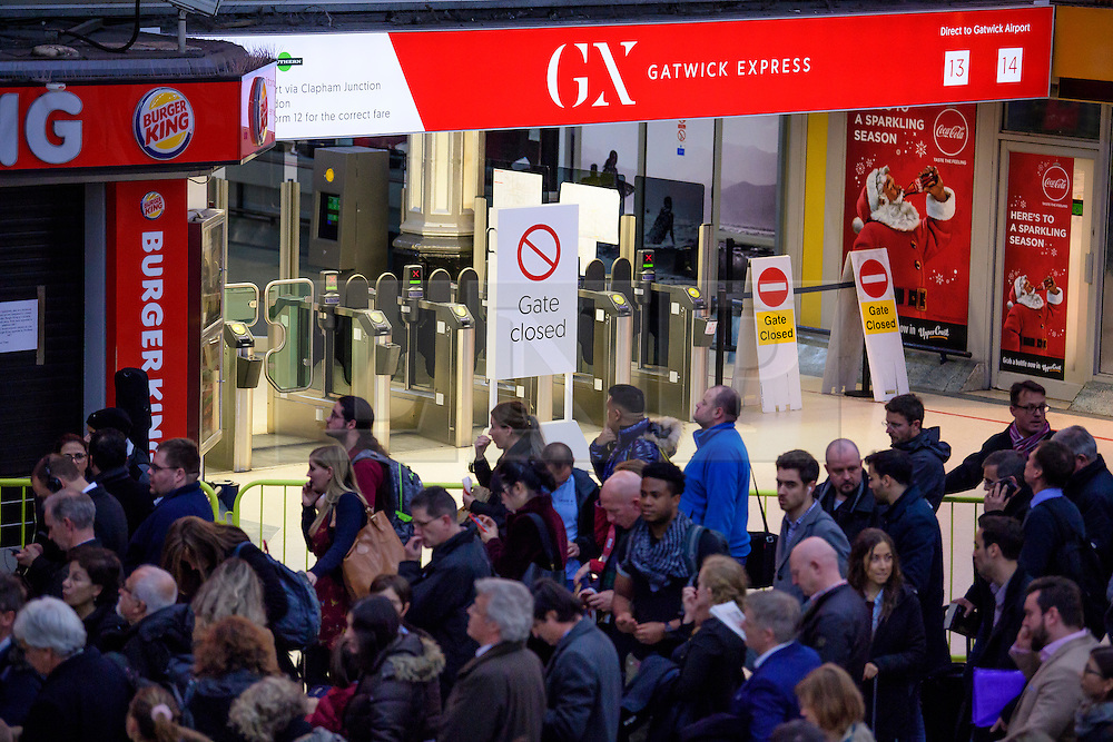 © Licensed to London News Pictures. 14/12/2016. London, UK. Members of the public queue in front of a closed gate sign, in the hope of getting a Southern Rail Gatwick Express train at afternoon rush hour at Victoria Station on 14 December 2016. Hundreds of thousands of rail passengers face a second day of a 3 day all-out strike in an escalating dispute over the role of conductors between Southern Rail and the RMT Union. Photo credit: Ben Cawthra/LNP