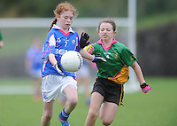21 Aug 2016:   Ciara Smith, left, Meath, in actioin against Sarah Carraher, Monaghan. Girls U12 Gaelic football final, Skryne, Meath (blue) v Clontibret, Monaghan (green).  2016 Community Games National Festival 2016.  Athlone Institute of Technology, Athlone, Co. Westmeath. Picture: Caroline Quinn