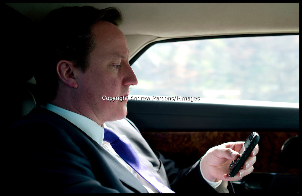 The Prime Minister David Cameron traveling back in his official car to his West Oxfordshire office on his blackberry during the Libya crisis, Friday April 15, 2011. Photo By Andrew Parsons/ i-ImagesThe Prime Minister David Cameron traveling back in his official car to his West Oxfordshire office on his blackberry during the Libya crisis, Friday April 15, 2011. Photo By Andrew Parsons/ i-Images