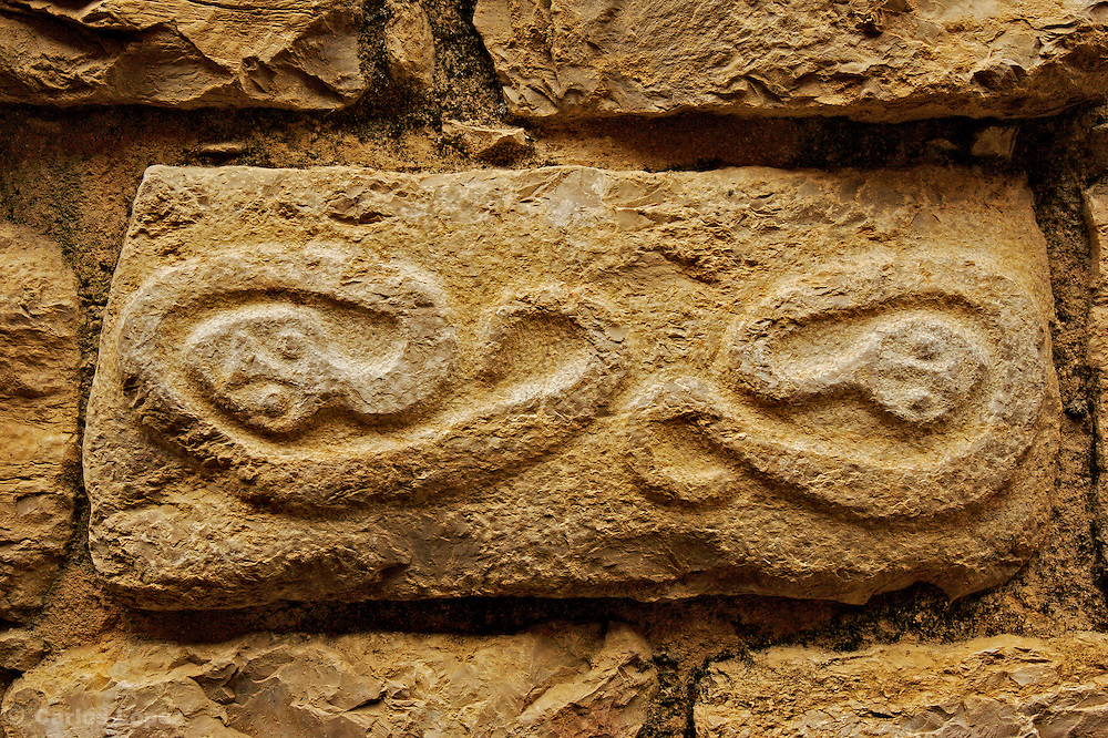 Faces on the wall of the fort of Kuelap