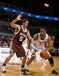 Virginia forward Mike Scott (32) is guarded by Brown center Stefan Kaluz (50).  The Virginia Cavaliers defeated the Brown University Bears 74-50 in NCAA Basketball at the John Paul Jones Arena on the Grounds of the University of Virginia in Charlottesville, VA on January 6, 2009.