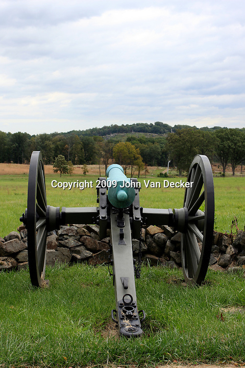 Confederate Army cannon position. Union Army's Little Round Top position visible in the distance. Gettysburg.