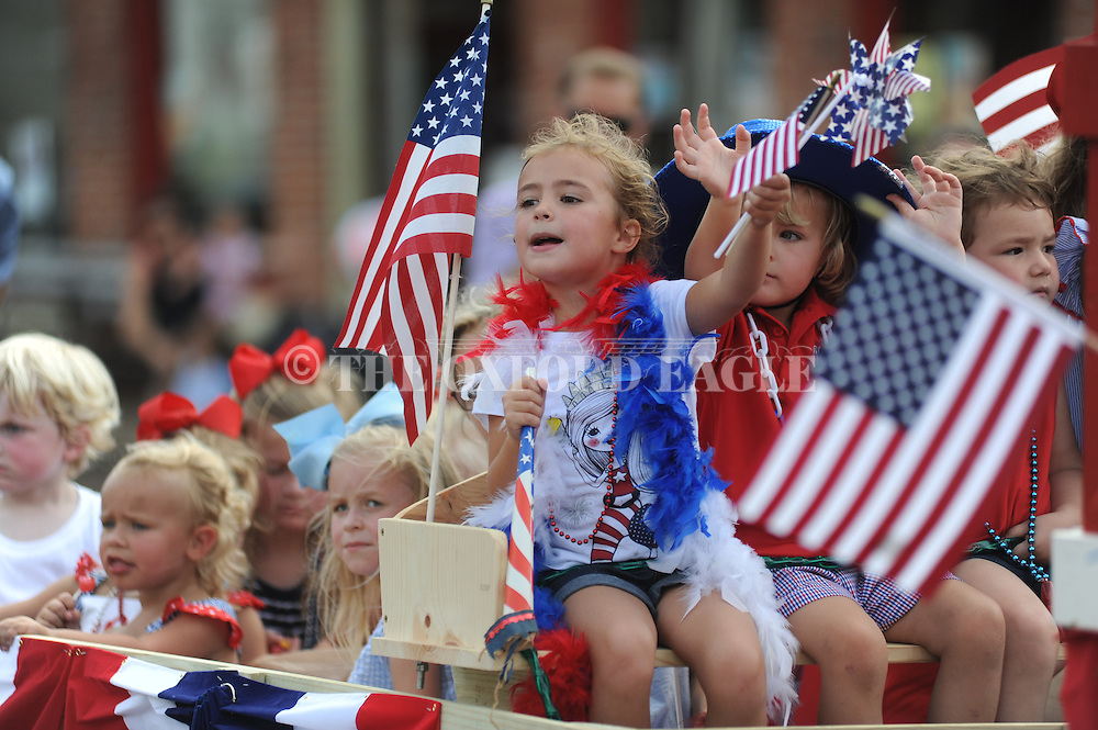 Kayle Malloy cheers while riding in the 4th of July parade in Oxford, Miss. on Monday, July 4, 2016.