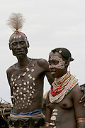 Africa, Ethiopia, Omo Valley, Karo tribesmen warrior and woman
