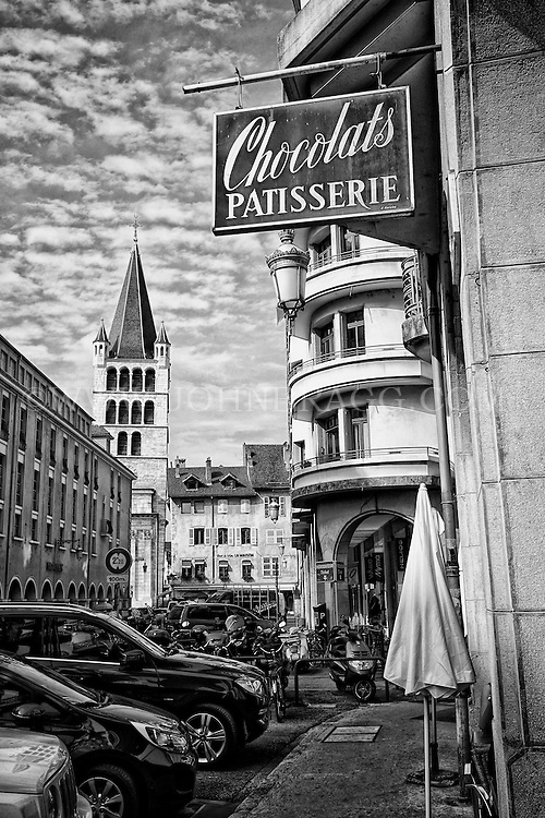 Black and white view of Philippe Rigollot Chocolats & Patissier, and Tearoom, Notre-Dame-de-Liesse Church, and other historic, Neo-Classic buildings, Old Annecy, France.