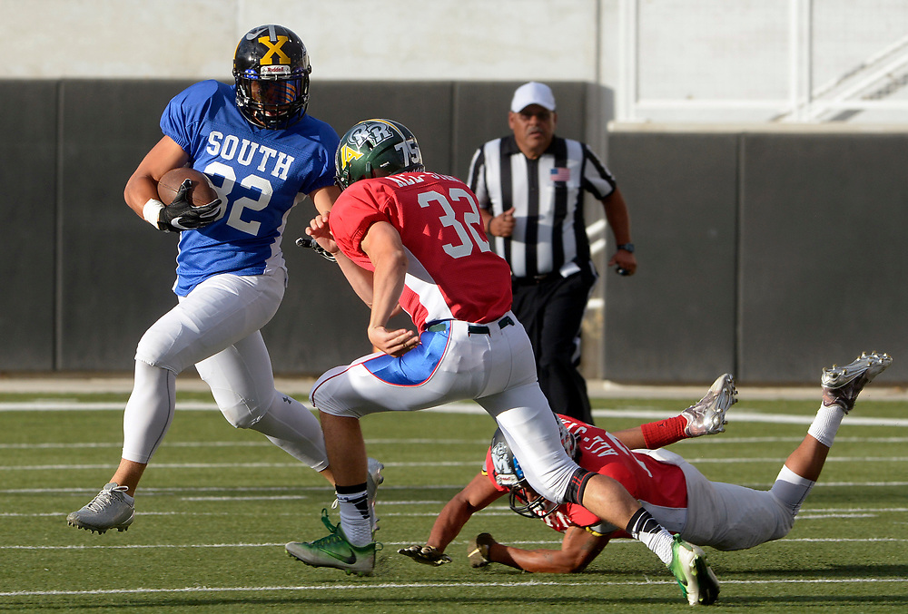 gbs072517g/SPORTS -- Onate's Matt Young, left, returns a kick-off at the start of the North South All-Star game in Nusenda Community Stadium in Albuquerque on Tuesday, July 25, 2017.(Greg Sorber/Albuquerque Journal)