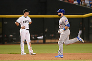 Aug 11, 2017; Phoenix, AZ, USA; Chicago Cubs catcher Alex Avila (13) runs the bases in front of Arizona Diamondbacks infielder Jake Lamb (22) after hitting a solo home run in the sixth inning of the MLB game at Chase Field. Mandatory Credit: Jennifer Stewart-USA TODAY Sports