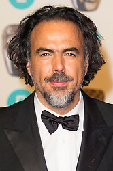 © Licensed to London News Pictures. 14/02/2016. London, UK. ALEJANDRO GONZALEZ INARRITU arrives carpet for the EE British Academy Film Awards 2016 after party held at Grosvenor House . London, UK. Photo credit: Ray Tang/LNPPhoto credit: Ray Tang/LNP