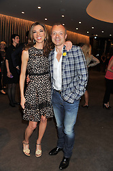 GRAHAM NORTON and HEATHER KERZNER at the launch of Samsung's NX Smart Camera at charity auction with David Bailey in aid of Marie Curie Cancer Care at the Bulgari Hotel, 171 Knightsbridge, London on 14th May 2013.