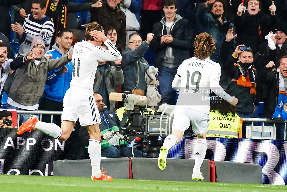 Gareth Bale (Real Madrid F.C.), Luka Modric (Real Madrid F.C.) celebrate a goal during Real Madrid v Levante CF, La Liga football match at Santiago Bernabeu on March 15, 2015 in Madrid