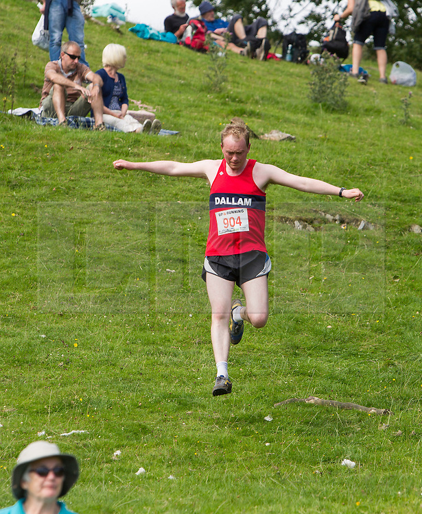 © Licensed to London News Pictures . 30/07/2015 . Ambleside , UK . TIM FARRON , newly elected leader of the Liberal Democrat Party in the UK and MP for Westmorland and Lonsdale , running in the Lake District National Park . Photo credit: Joel Goodman/LNP