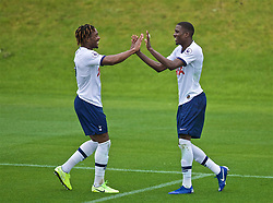 KIRKBY, ENGLAND - Saturday, August 10, 2019: Tottenham Hotspur's Shilow Tracey (R) celebrates scoring the fourth goal with team-mate Kazaiah Sterling during the Under-23 FA Premier League 2 Division 1 match between Liverpool FC and Tottenham Hotspur FC at the Academy. (Pic by David Rawcliffe/Propaganda)