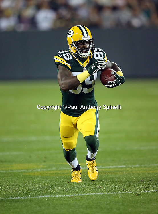 Green Bay Packers wide receiver James Jones (89) catches a flat pass good for a gain of 12 yards and a first down in the first quarter during the 2015 NFL week 3 regular season football game against the Kansas City Chiefs on Monday, Sept. 28, 2015 in Green Bay, Wis. The Packers won the game 38-28. (©Paul Anthony Spinelli)