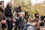 A crowd including two attentive boys listening to the Doug Wamble Quartet at the Jazz and Colors festival in Central Park.
