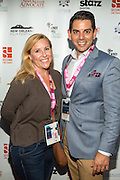 Miguel Solorzano and guest on the red carpet during opening night of the 25th Anniversary New Orleans Film Festival; Opening night film is 'Black and White' directed by Mike Binder