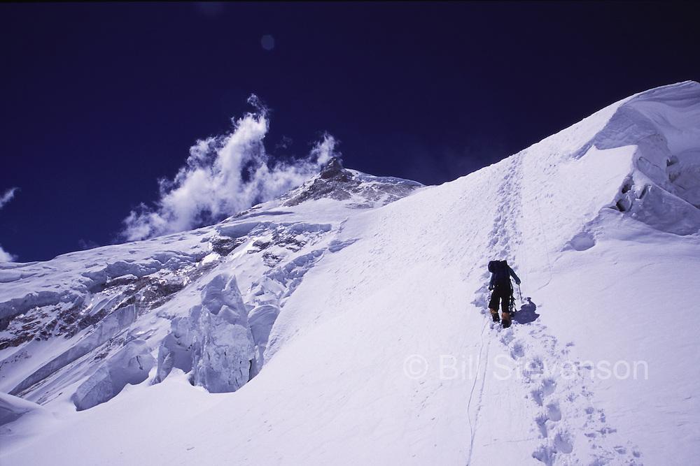 A man climbing to camp 2 on Manaslu in Nepal.