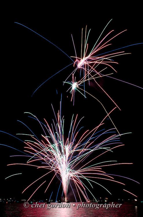 Fireworks explode over Greenwood Lake, NY on Sunday, July 3, 2016.  © Chet Gordon • Photographer