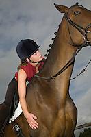 Girl on horseback low angle view