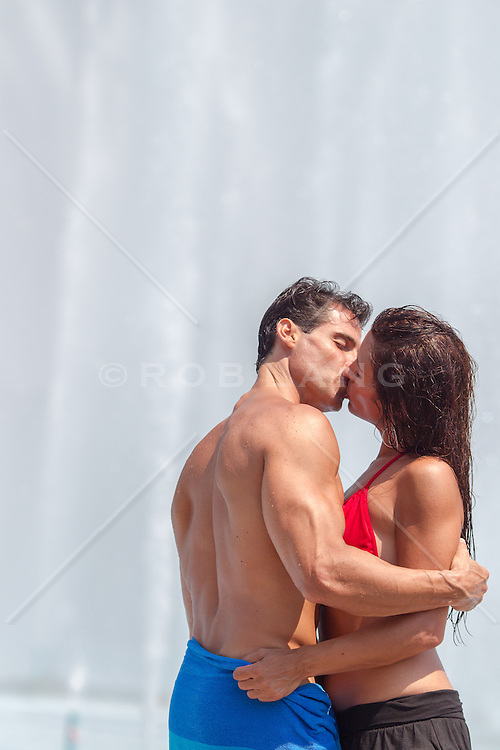 sexy couple outdoors kissing