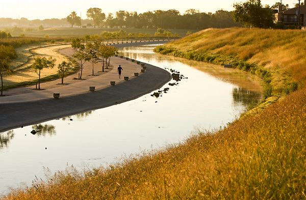 Man walking along the bayou at sunset at Storey Park in Houston, Texas